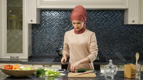 Housewife Prepares Dinner for Family Cutting Vegetables