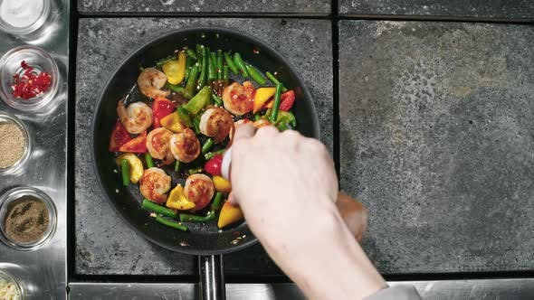 Thumbnail for Cook Pouring Sauce on Shrimps and Vegetables Dish