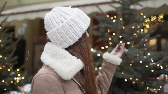 Thumbnail for Girl Touching Christmas Tree on the Street