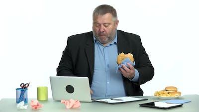 Overweight Businessman Eating Junk Food