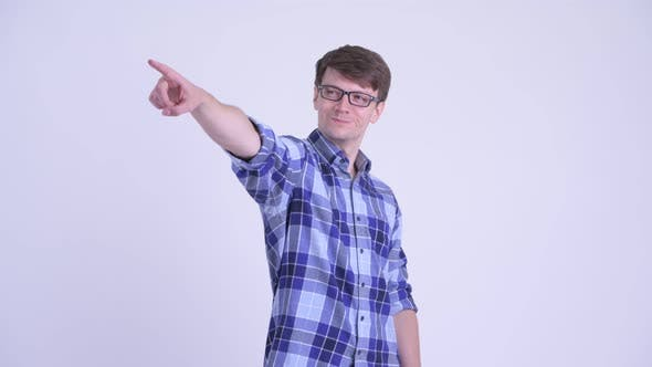 Cover Image for Happy Young Handsome Hipster Man Pointing Finger