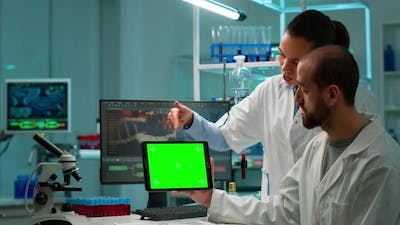 Professional Chemists Working on Tablet with Chroma Key Screen