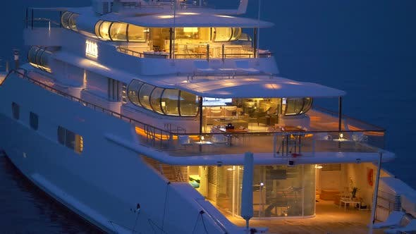 Thumbnail for A luxury yacht anchored at night in a resort town in Italy, Europe.
