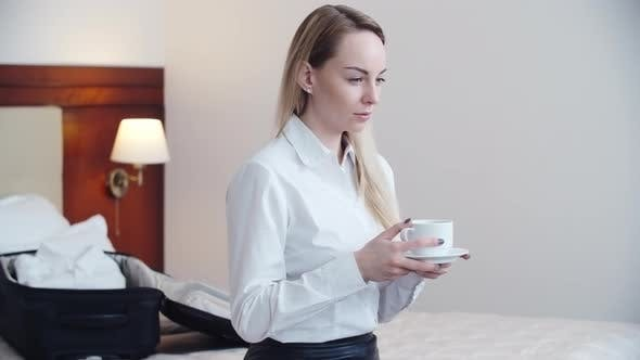 Thumbnail for Businesswoman Drinking Coffee in Hotel Room