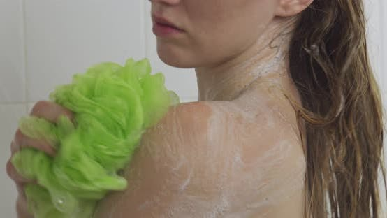 Cover Image for Woman Showering Soap Suds