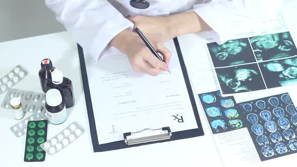 Thumbnail for Doctor Fills Out Medical Prescription Forms