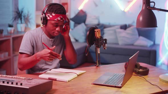 Thumbnail for Afro-American Musician Writing a Song in Home Recording Studio