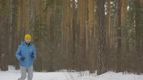 Thumbnail for Sportsman Running in Forest in Winter