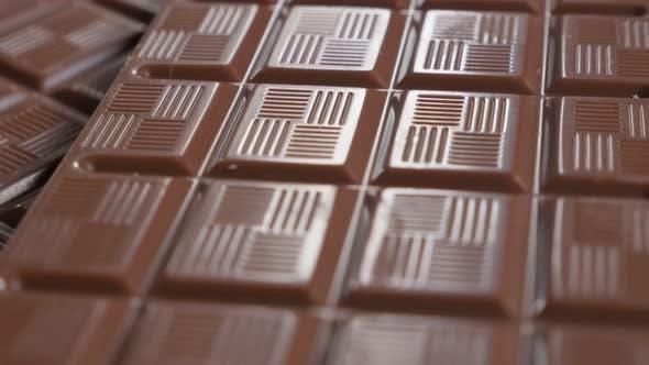 Dark milk chocolate shiny surface and blocks slow tilting 4K 2160p 30fps UltraHD video - Chocolate b