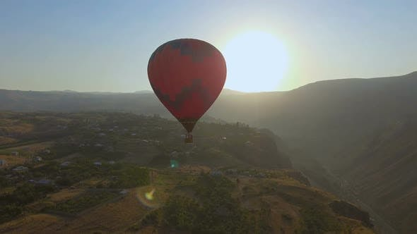 Thumbnail for Colorful Hot Air Balloon Flying Over Halidzor Village at Sunset, Landscape