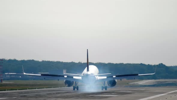Thumbnail for Widebody Airplane Landing at Morning