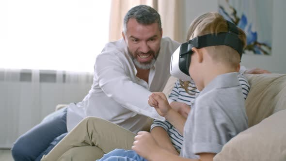Cover Image for Parents Watching Son Playing VR Game