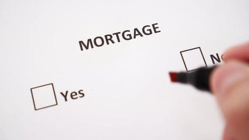 A hand puts a check mark next to the NO mark on white paper under the word MORTGAGE