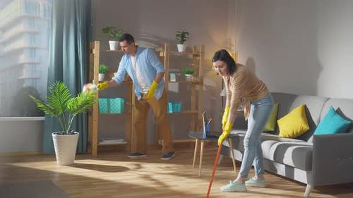 a Couple of Spouses Does Cleaning in an Apartment or House