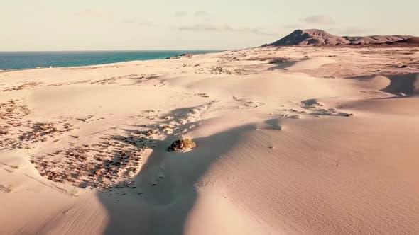 Above view of desert dunes - concept of wild adventure travel destination and wild beauty