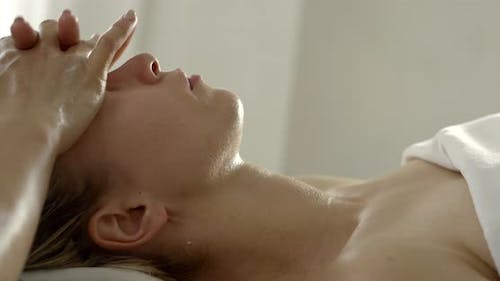 Masseur Practices Face Lifting Massage To Beautiful Lady