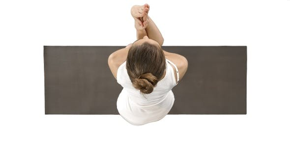 Thumbnail for Attractive girl standing in the balancing yoga pose Garudasana