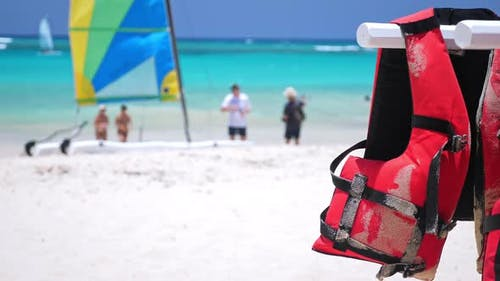 Life Safety Jackets on Tropical Beach. Lifejackets for Water Sport Activity