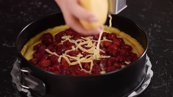 Thumbnail for Woman Grating Pastry Dough With A Grater On Cherry Pie. Cooking Process.