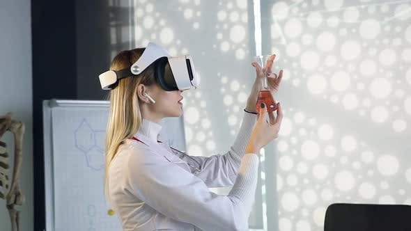 Thumbnail for Female Scientist in white Gown which Working with Flask with Chemical Solution Using Virtual Reality