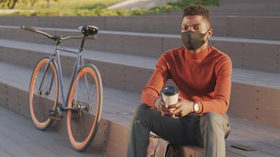 Portrait of African American Businessman in Face Mask Outdoors