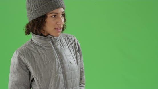 Thumbnail for African American millennial girl poses in her winter clothes on green screen
