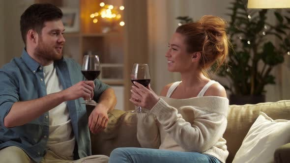 Cover Image for Happy Couple Drinking Red Wine at Home in Evening 49