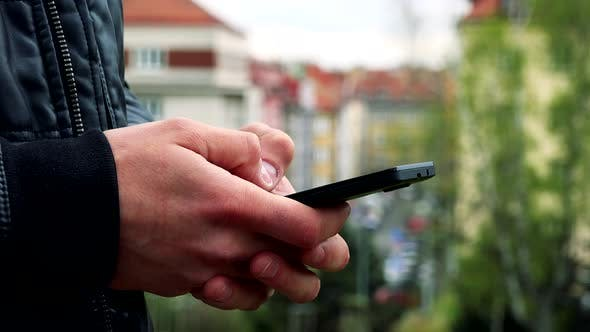 Thumbnail for Man Stands and Works on Mobile Phone - Detail of Hands