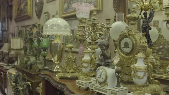 Thumbnail for Antique Shop Gold And Copper Girandoles Clocks Statues