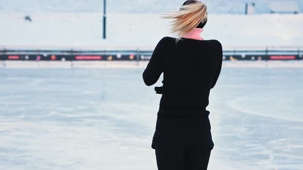 Thumbnail for Young Blonde Woman Figure Skating on Public Ice Rink