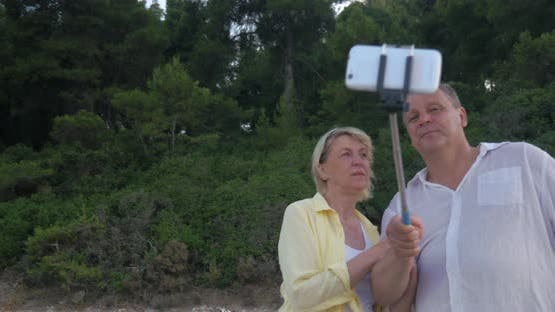 Couple with Smartphone and Selfie Stick