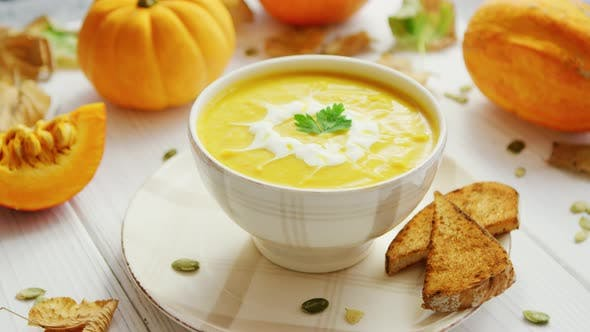 Thumbnail for Pumpkin Soup in Bowl Served with Bread