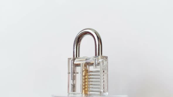 Thumbnail for Transparent Padlock Rotating on White Background