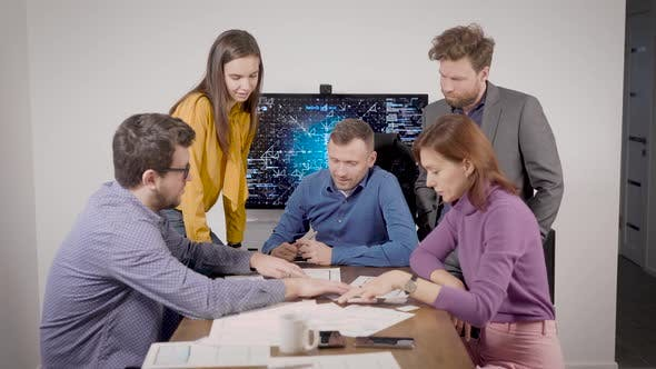 Thumbnail for Group of Technical Specialist Is Discussing New Technologies, Examining Technical Paper in Office