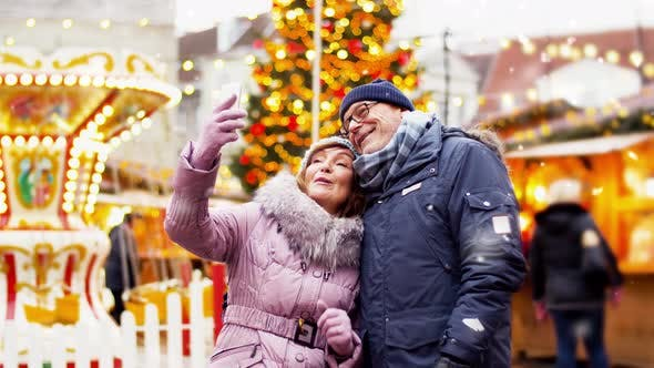 Thumbnail for Senior Couple Taking Selfie at Christmas Market