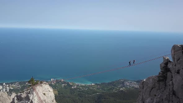 Thumbnail for A Top View of the Highest Mountain in Crimea - Ai-Petri and Several Tourists Climbing a Hike Over an