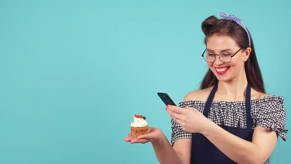 Thumbnail for Cheerful Pastry Girl Makes Photo of Her Cupcake