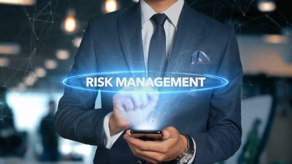 Thumbnail for Businessman Smartphone Hologram Word   Risk Management