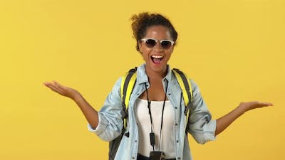 Surprised young African American woman backpacker