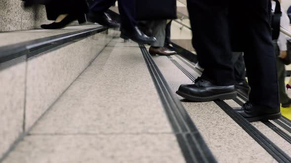 Low Angle Japanese Commuters Walking
