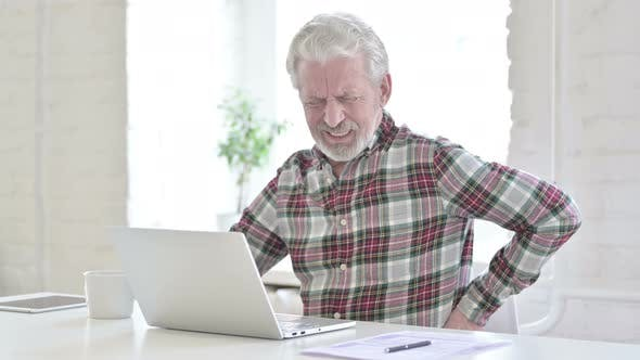 Tired Casual Old Man Having Back Pain in Office