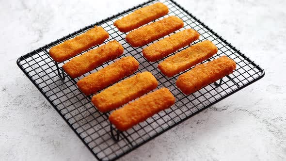Cover Image for Rows of Golden Fried Fresh Fish Fingers Fillets