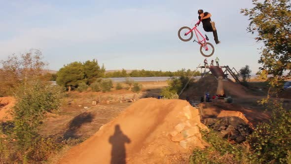 Thumbnail for A young man riding a BMX bicycle.