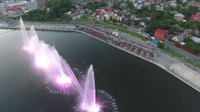 Beautiful Dancing Fountain. Aerial shot of the colorful illuminated musical fountain at dusk
