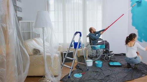 Handicapped Man Docorating