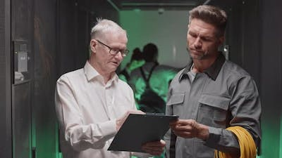 Engineer Talking to Electrician in Server Room
