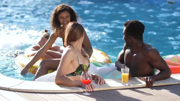 Thumbnail for Cheerful Diverse Friends Chatting Near Pool Side