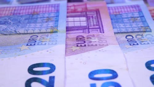Euro bills with the light of a police flasher