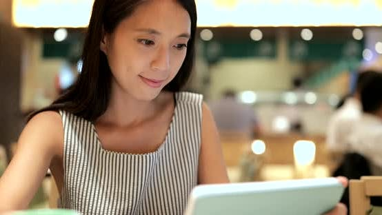 Thumbnail for Woman using tablet for ordering in restaurant
