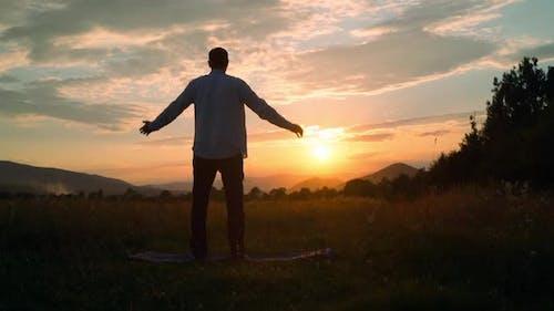 Calm Man Meditate at Sundown Slow Motion